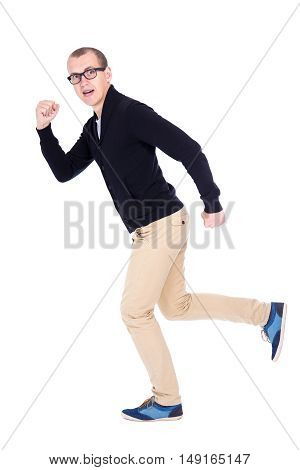 Side View Of Cheerful Young Man Student Or Office Worker Running Isolated On White