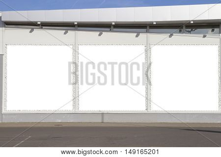Mock up. Three blank billboards on the shop or supermarket wall outdoors. Outdoor advertising,
