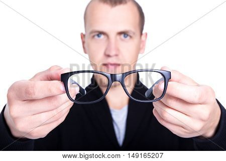 Close Up Of Eyeglasses In Male Hands Isolated On White