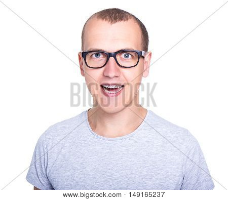 Funny Young Man In Glasses With Braces On Teeth Isolated On White