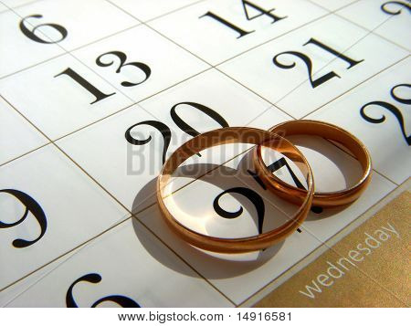 Wedding rings and calendar