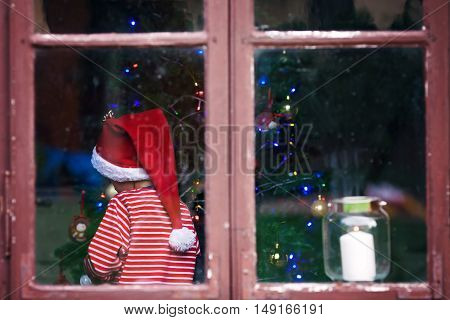 Cute Boy, Decoration Christmas Tree In Striped Pajama And Christmas Hat