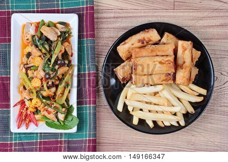 Chinese Vegetable festival  food as fried basil with mixed vegetables served deep fried spring roll and French fries are food for Chinese Vegetable festival of Chinese as