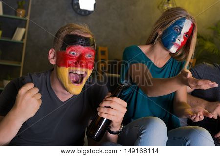 Shot of football fans expressing their emotions while watching a game