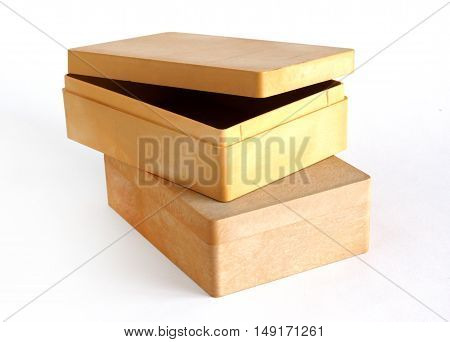 Two beige plastic boxes on a white background
