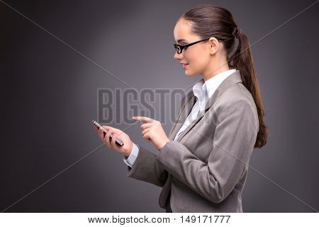 Businesswoman texting and sending text messages