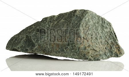 fragment of grey granite with splashes of mud on a white background