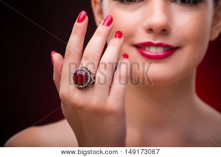 Woman with nice ring in beauty concept