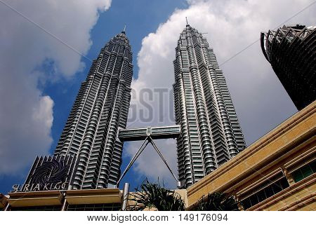 Kuala Lumpur Malaysia - December 23 2007: The 1482 foot high 1987 twin Petronas Towers with connecting sky bridge designed by Cesar Pelli *