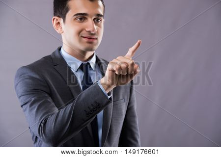 Businessman pressing buttons in business concept