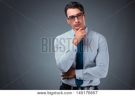 Handsome businessman against gray background