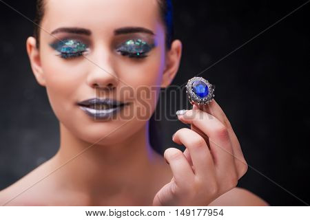Woman with ring in beauty concept