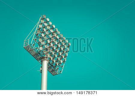 Stadium light against blue sky vintage tone