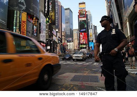 Police Officer And Cab In Times Square