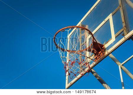 Basketball hoop on a blue sky. Basketball sport.