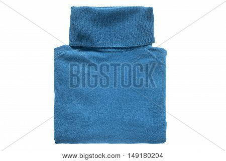 Folded blue cashmere sweater isolated over white