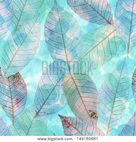 A seamless watercolor background pattern with teal blue skeleton leaves, faded and toned