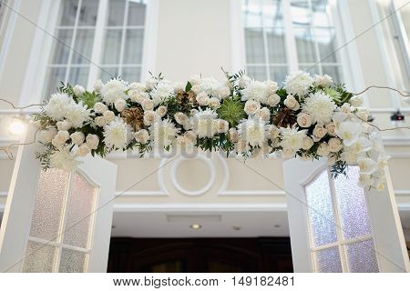 Beautiful Wedding Arch For Marriage Decorated With Lace Fabric And Flowers. White Decor For Bride An
