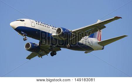 SAINT PETERSBURG, RUSSIA - JULY 24, 2015: Boeing 737-5Y0 (EI-DTW) of the company Transaero in flight closeup