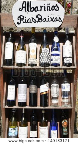 CAMBADOS, SPAIN - AUGUST 8, 2016: Bottles of Galicia white wine on shelf in Cambados Galica Spain