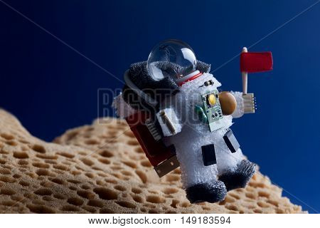 Spaceman floating stratosphere, planet blue sky background. Light bulb character dressed in spacesuit astronaut ammunition. Flying cosmonaut with red flag. cosmos exploration conceptual image.