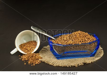 Instant coffee in a glass dish. Preparation of soluble coffee. Decorate store coffee.