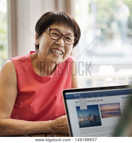 Senior Couple Using Laptop Concept