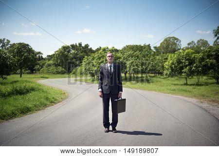 Businessman Standing Green Grass Thinking Concept