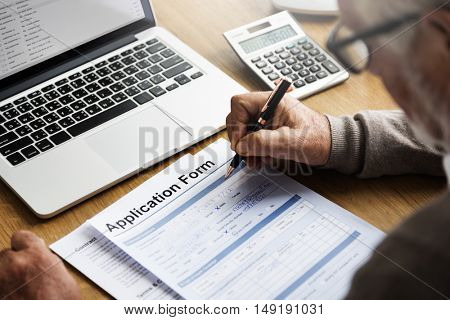 Senior Man Filling Application Form Documents Concept