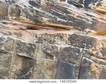 wall with beautiful texture mottled gray natural stone beige with potholes and cracks