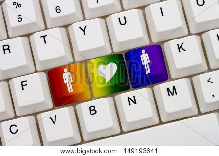 Gay Internet Dating Sites A close-up of a keyboard with rainbow color highlighted symbol of man and a man and heart
