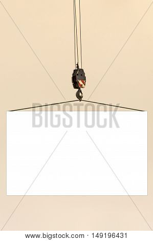 Construction crane hook lifting blank board with copy space for your text