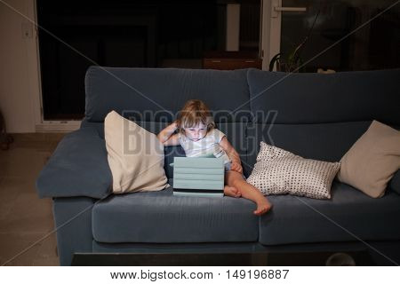 Sofa With Child Watching Tablet