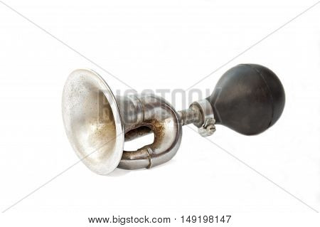 Old fashioned rusty bike horn isolated on white background