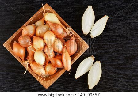 White small onions in a wooden bowl