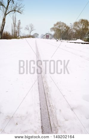 Train tracks covered with snow in winter.
