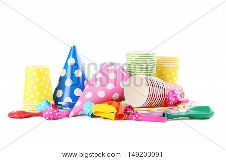 Birthday paper cups with caps whistles and balloons isolated on a white
