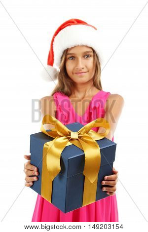 Portrait Of Young Girl In Santa Claus Hat With Gift Box