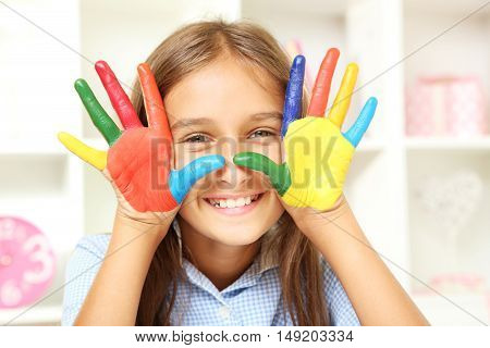 Beautiful Little Girl With Painted Hands