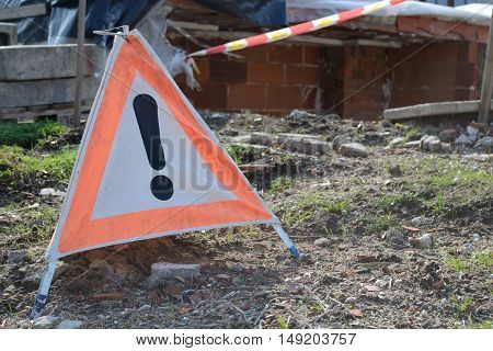 Warning sign as an indication of dangers on site