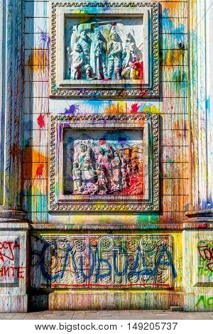 Vandalism of the triumphal arch in Skopje. Skopje, Macedonia - September 24, 2016: Splashes of color on Porta Macedonia, the triumphal arch in the center of Skopje. Color traces after manifestation.