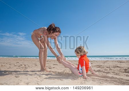 Funny Woman Dragging Child On Sand Beach