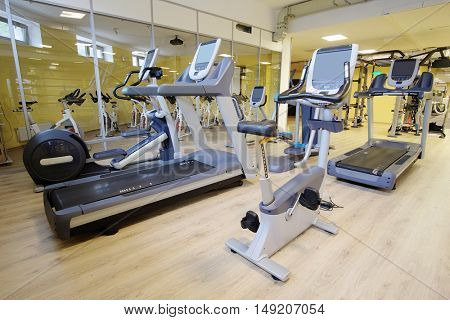 Interior of a modern fitness hall with treadmill