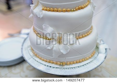 Beautiful Wedding Cake For Bride And Groom Indoors. Colorful Pie For Celebration. Beauty Of Bridal I