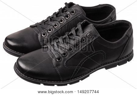 Pair of black men's shoes isolated on white background. Footwear is located at an angle to the camera