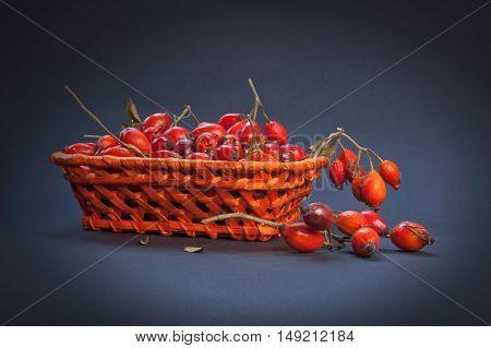 Ripe roses hip (dog rose fruit) in a basket.