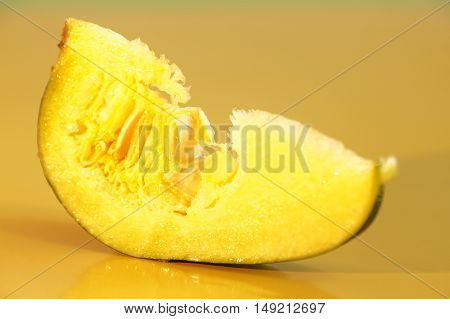 Yellow and ripe pumpkin lie on a bright background.