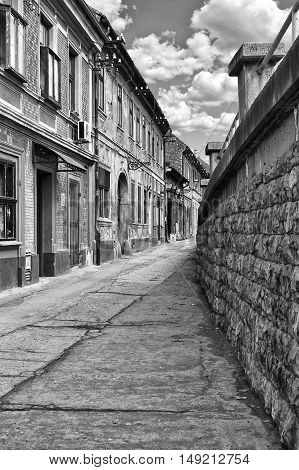 Streets with old houses of the old town of Petrovaradin near Novi Sad in Serbia. Black and white image.