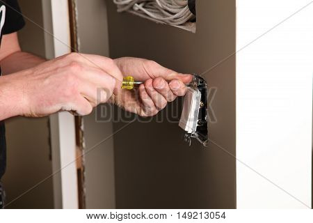 An Electrician working on a new construction site