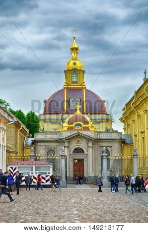 ST PETERSBURG RUSSIA - JUNE 19 2015. Tourists near Grand Ducal Burial Vault Imperial house of Romanov in the Peter and Paul Cathedral located inside the Peter and Paul Fortress